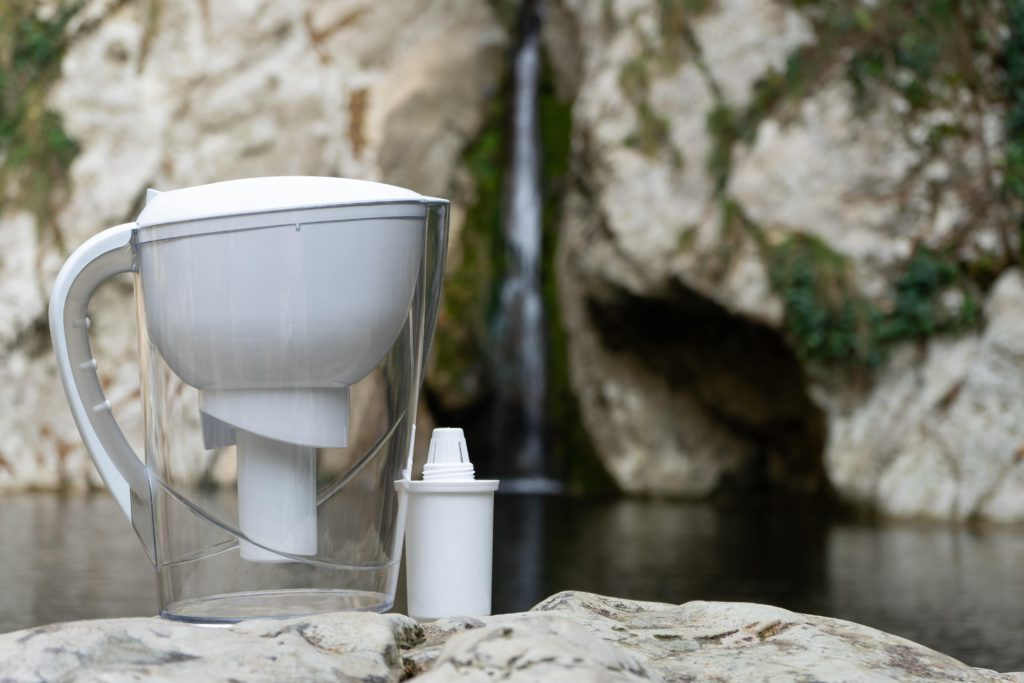 Water filter pitcher near waterfall